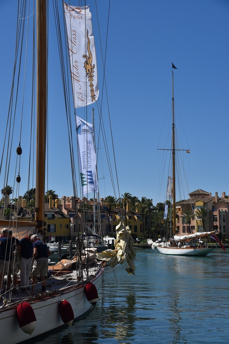 classic sailing ship lies in the harbor with the water of Pineo